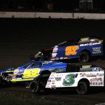 The 52 of Erin Shane battles for position with 3J Chad Johnson and 97 Jody Kropp in the modified main event June 1, 2012